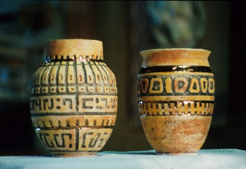 These artifact vessels suggest a sense of the past with their ...